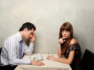 image of couple at table with man worried about losing woman